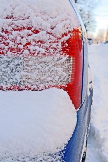 Car bumper covered by snow