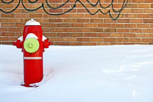 Red fire hydrant in winter