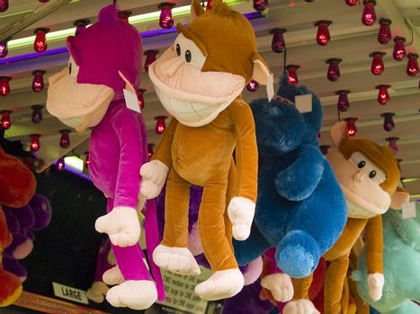 Lots of stuffed animals at a carnival.