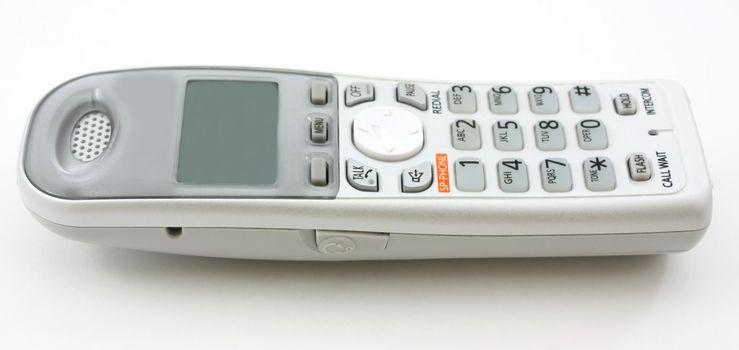 White portable home phone, horizontal