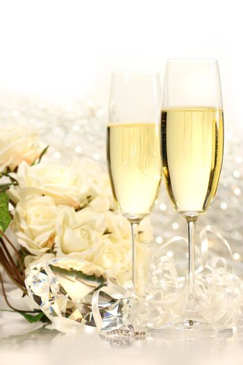 Champagne glasses ready for wedding festivities with roses