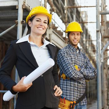 Portrait of construction worker and female architect.