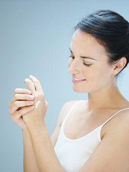 woman massaging hands