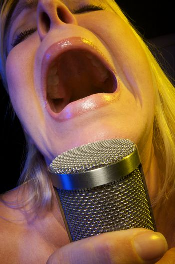 Woman with Microphone Sings with Passion