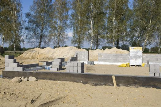 The building site where begins construction of the new house
