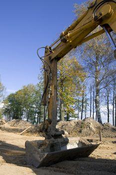 Excavator in actioin in building trade