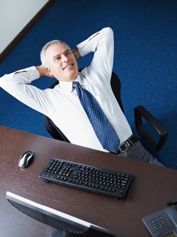 mature businessman relaxing in office
