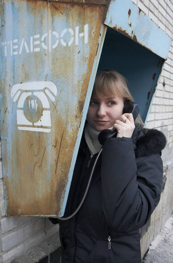 Upset girl with street phone