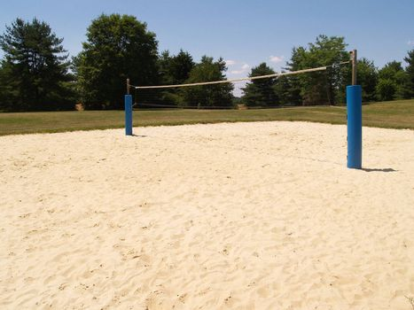 an empty outdoor sand volleyball court