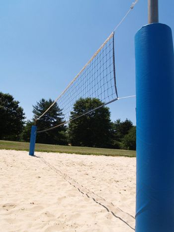 sideview of an outdoor sand volleyball court