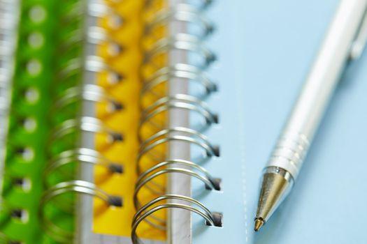pen on top of ring binders