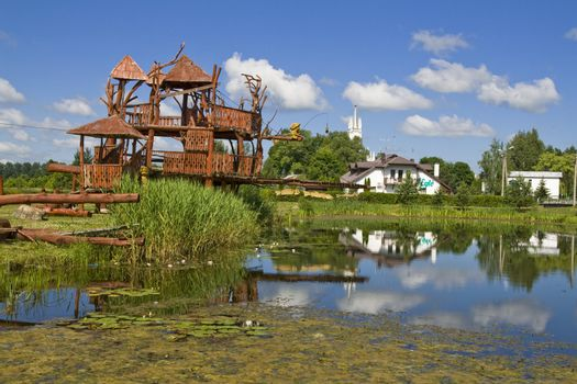 """Park for rest in the Lithuanian village. Celebrity of park - the """"house of monkeys"""""""