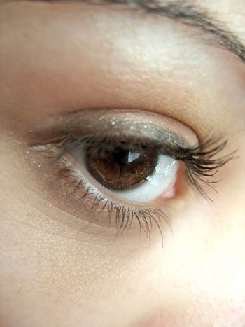 A macro shot of a pretty eye and lashes - shallow depth of field.