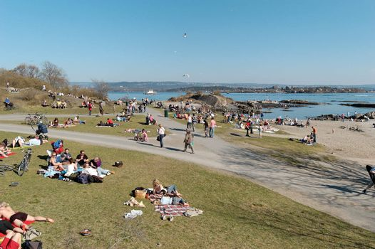 People of Oslo seek to the public beach at Bygdøy on the first warm days of the spring.