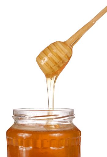 Honey jar isolated on white background