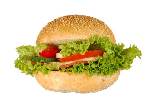 Sandwich - roll with ham, cheese and vegetables isolated on white