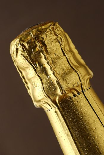close up of foil covered champagne cork