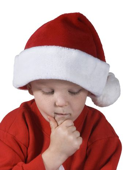 isolated child with santa hat thinking or wishing