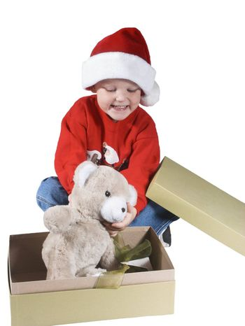 child opening a present and happy