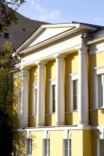 Facade of mansion with columns at summer time. Moscow, Russia.