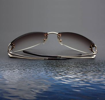 glasses on a grey background