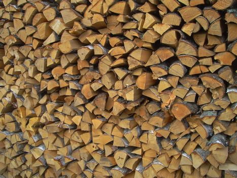 Wood texture. nature  pattern.  A woodpile of birch fire wood, preparation of fuel for the winter.
