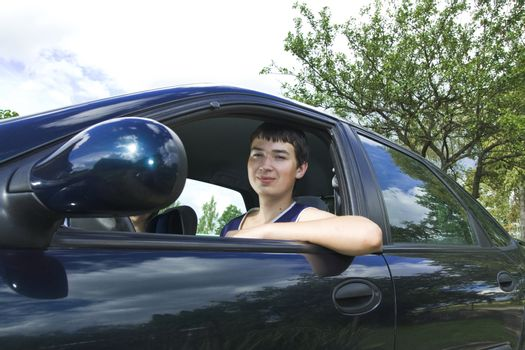 19th years old man driver in a car