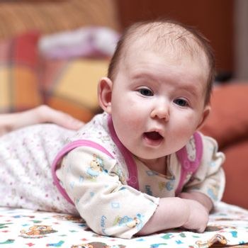 Cute baby-girl with her mouth open