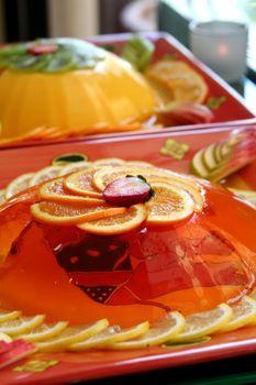 Jelly gelatine dessert dish served with sliced oranges