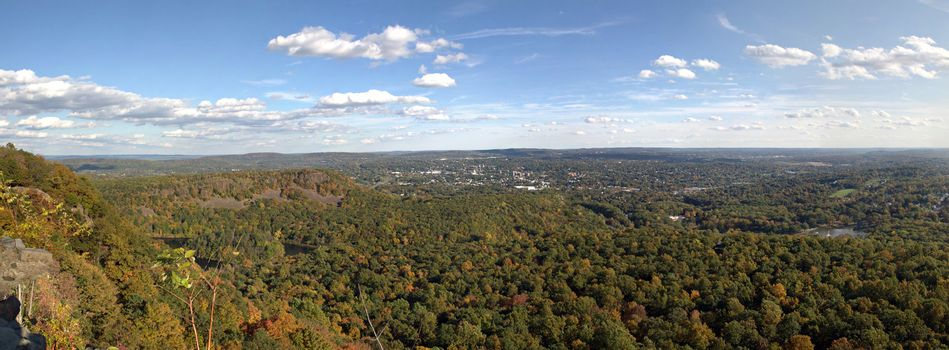A gorgeous panoramic view of the fall foliage in Meriden Connecticut and Hubbard Park from Craigs Castle.