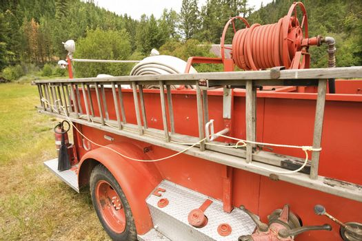 Close-up of old fire truck and ladder.