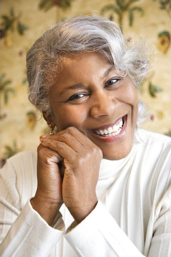 Portrait of mature African American woman smiling at the viewer.