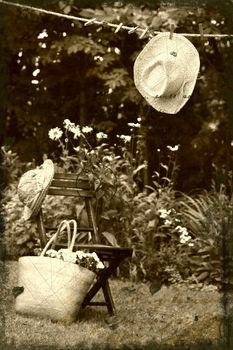 Straw hat hanging on clothesline