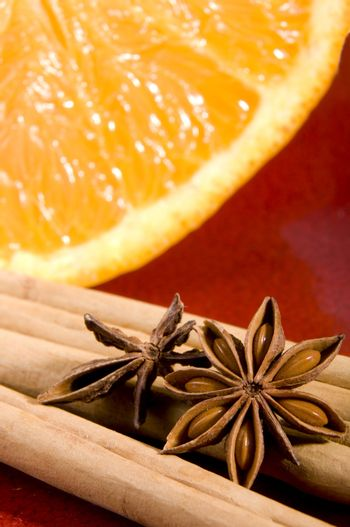 Cinnamon, anise and orange close up composition
