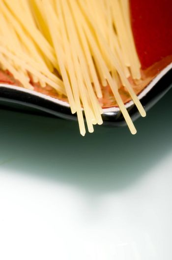 Pasta stripes on red plate