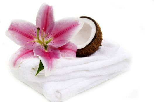 Coconut, lilly flower and white towel