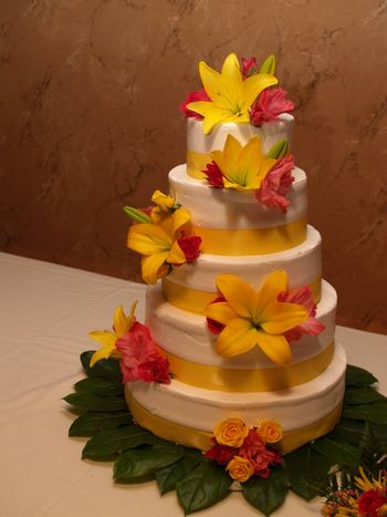 tiered wedding cake with yellow lilies