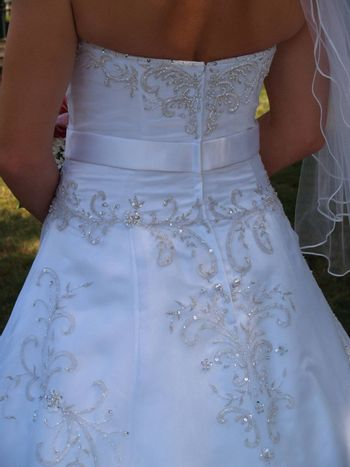 closeup view of the back of a wedding gown