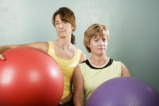 Women Posing With Exercise Balls