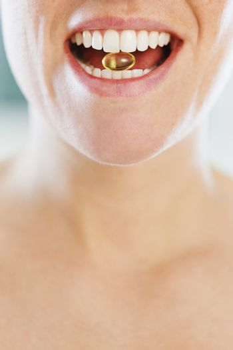 woman eating pill