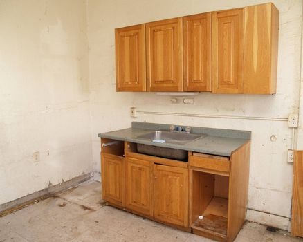 an outdated kitchen in need of repair and remodeling