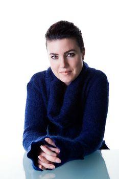 Beautiful brunette woman wearing a blue pullover.