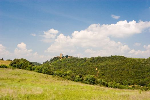 A castle on top of a hill in Tuscany, Italy