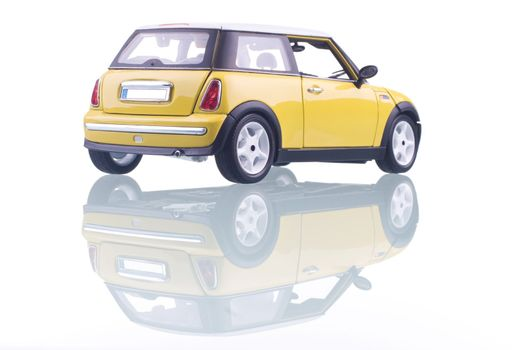 Yellow car with reflection. Studio shot.