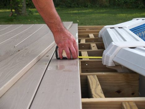 measuring for new boards for an above ground pool deck