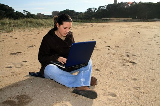 woman working with laptop on the coast