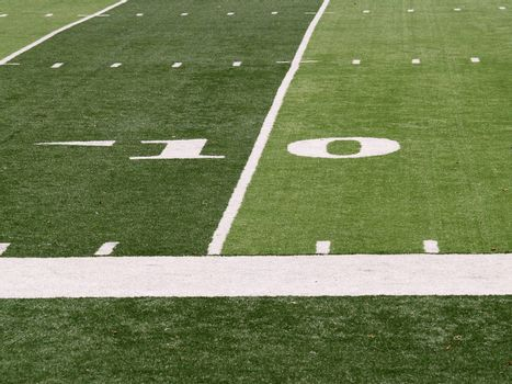 10 yard line markings on an artificial turf football field