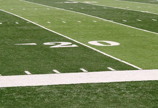 20 yard line markings on an artificial turf football field