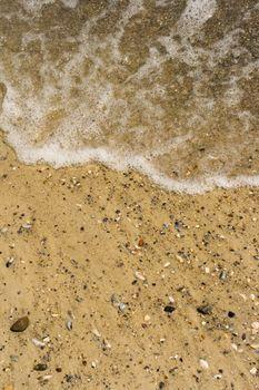 wave on a sandy beach