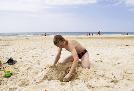 Young teenager playing on the beach